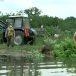 /VIDEO/ Inundații la Speia. Militarii au venit în ajutorul localnicilor