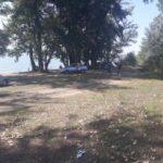 FOTO/ Kilometri de gunoaie pe malul lacului Costești-Stânca